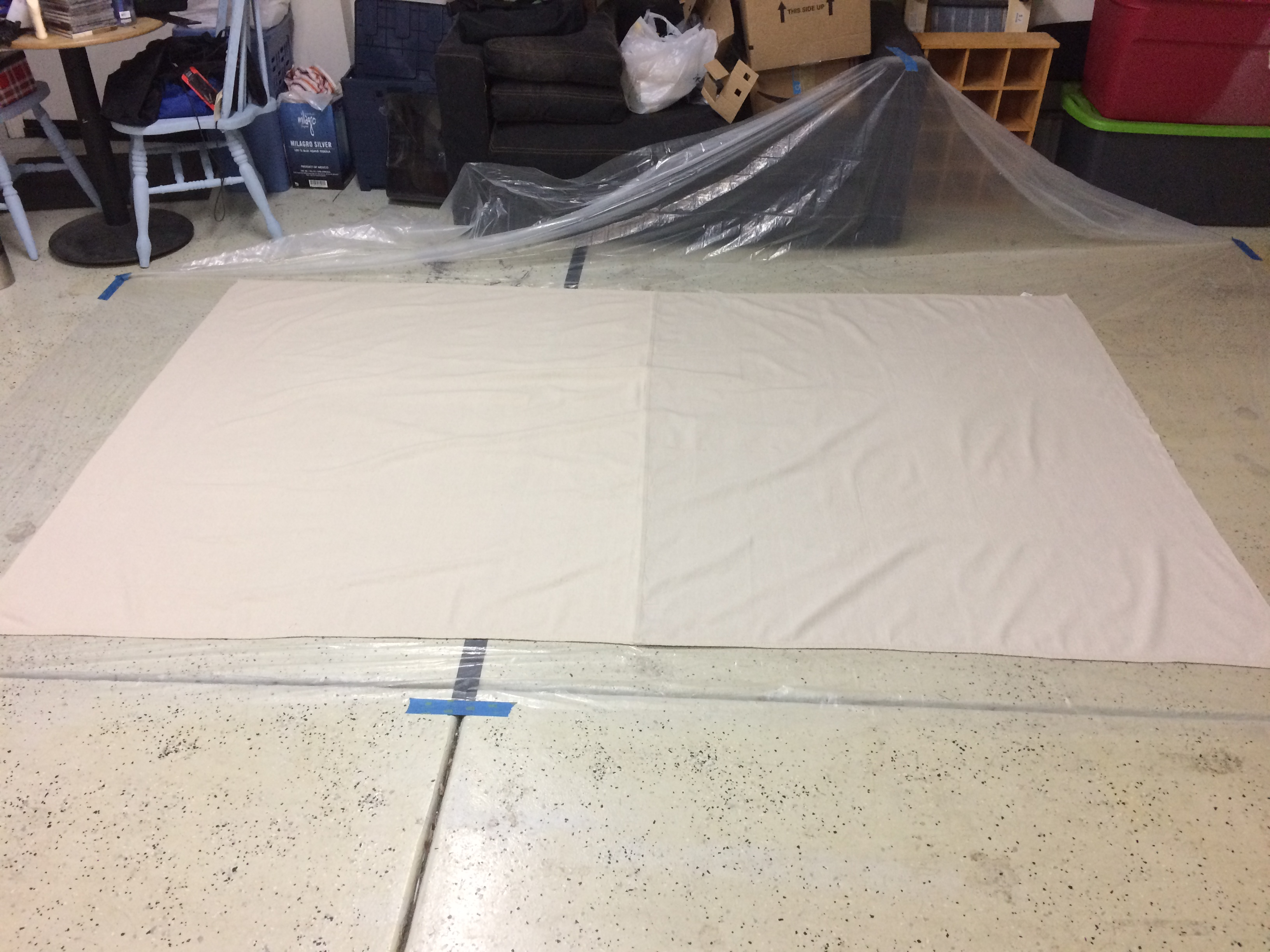 i got home and cleared a space in the garage then i washed dried and ironed my drop cloth once i had laid down the protective plastic i got